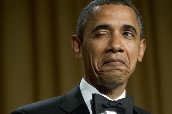 US President Barack Obama winks as he te