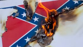 Activists In Los Angeles Gather To Burn Likenesses Of The Confederate Flag