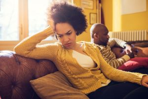 African American couple having relationship difficulties at home.