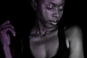 Dark skinned woman pensive
