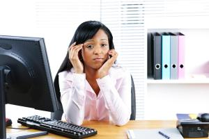 Worried black businesswoman at desk