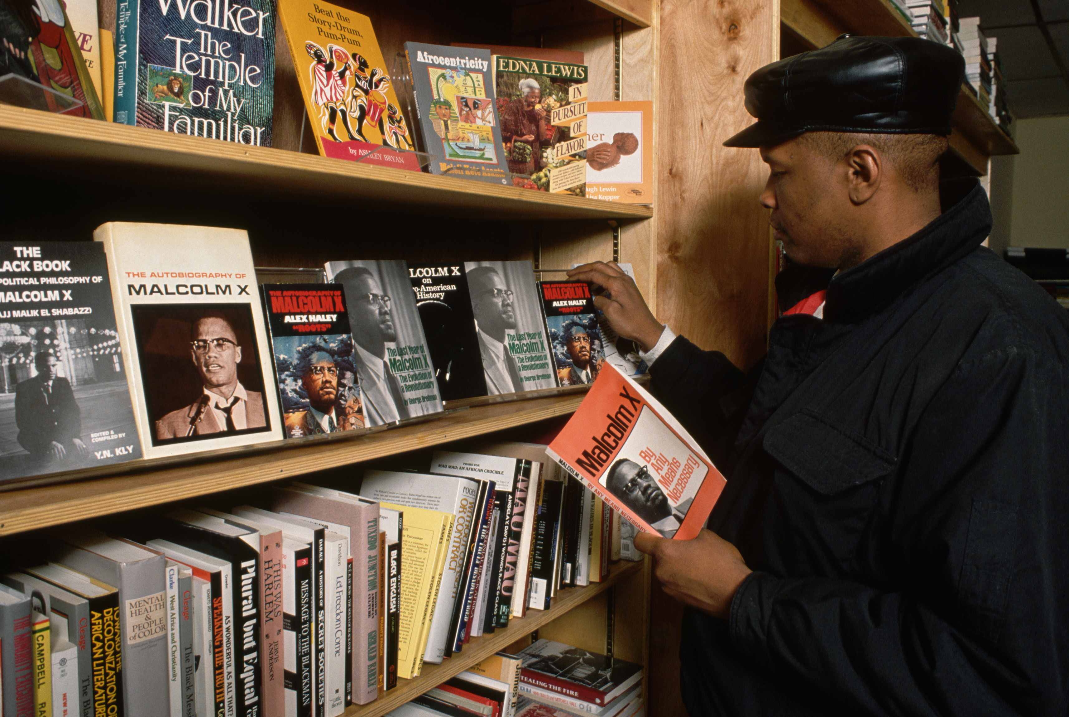 Man Looking at Malcolm X Books