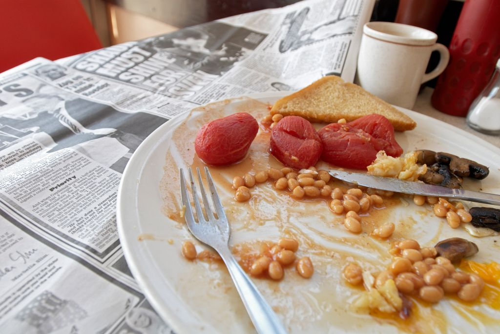 Builder's cafe with full breakfast on table.