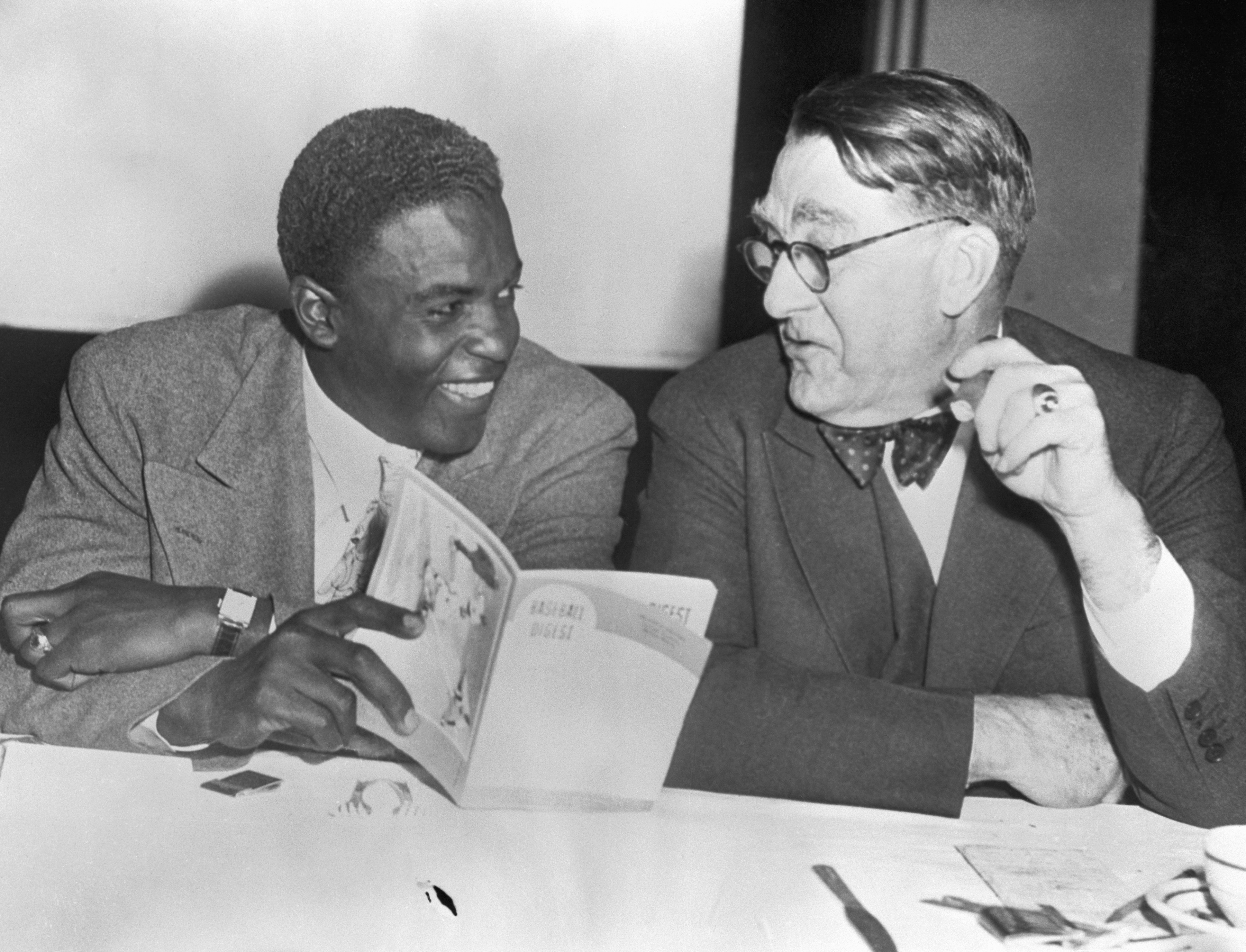 Jackie Robinson and Branch Rickey Looking at Book