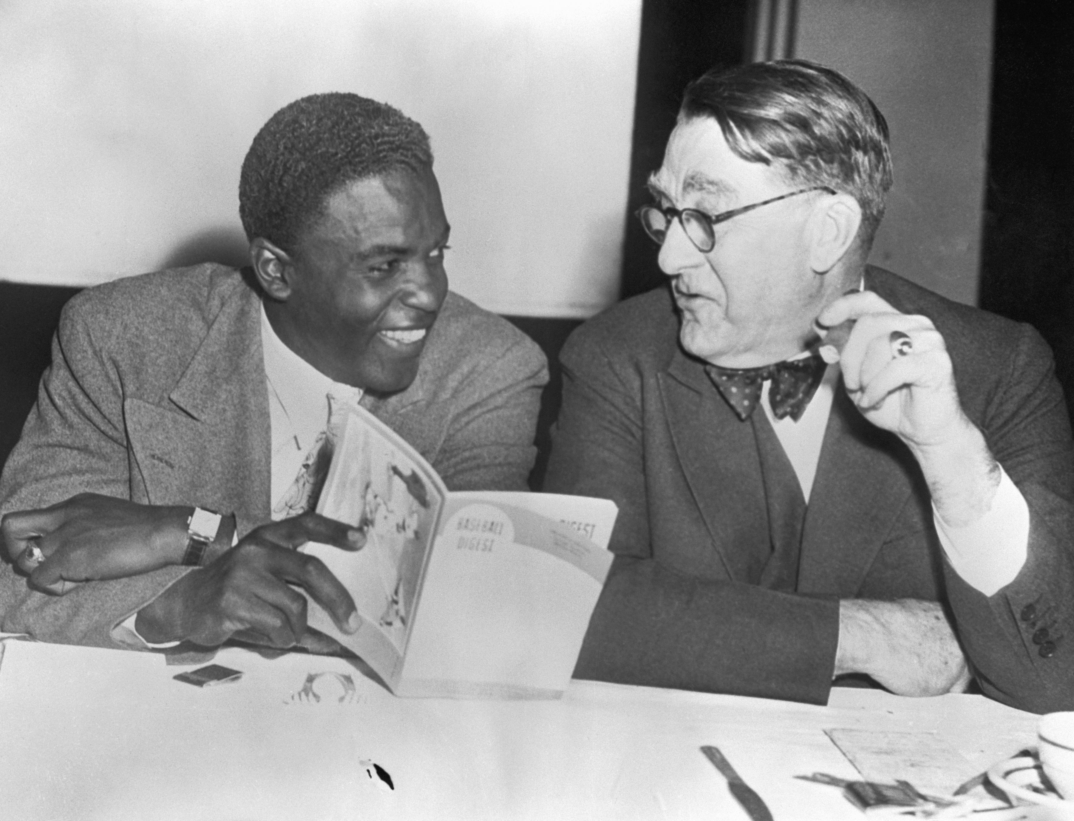 Jackie Robinson and Branch Rickey Looking at Book