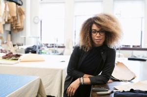 Portrait confident female fashion designer in studio